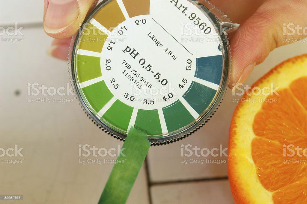 pH value determination orange fruit stock photo