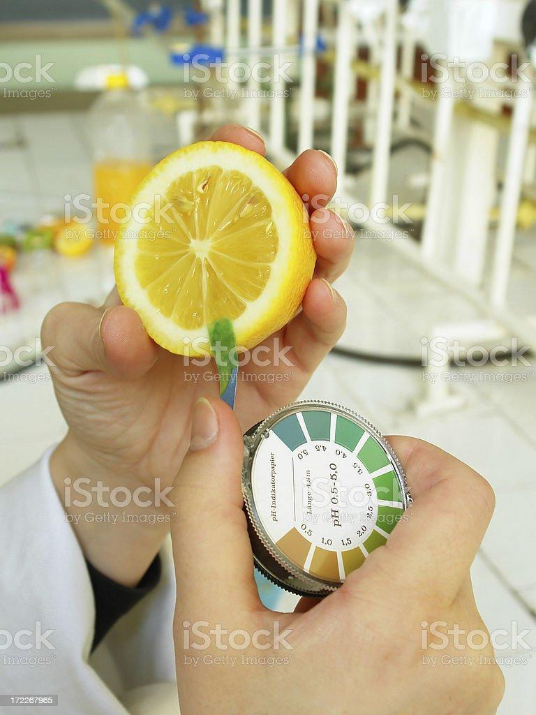 pH value determination (lemon fruit) royalty-free stock photo