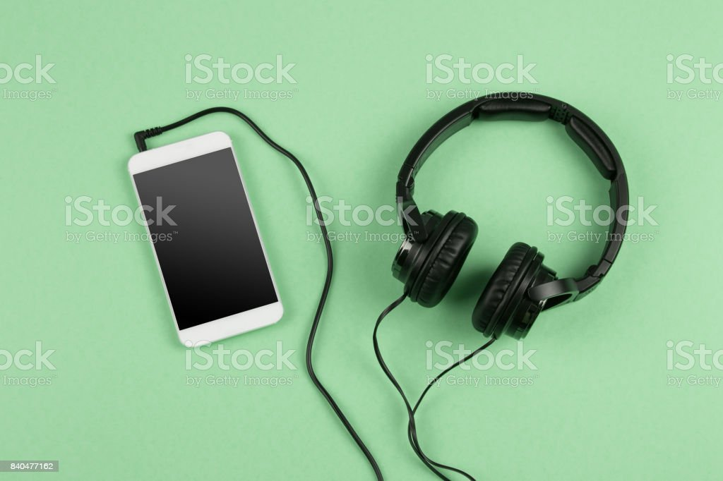 phablet and headphones on the color background stock photo
