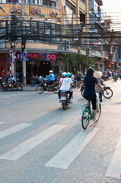 pham ngu lao, a backbacker area in hcmc, vietnam - motorbike, umbrella stock pictures, royalty-free photos & images