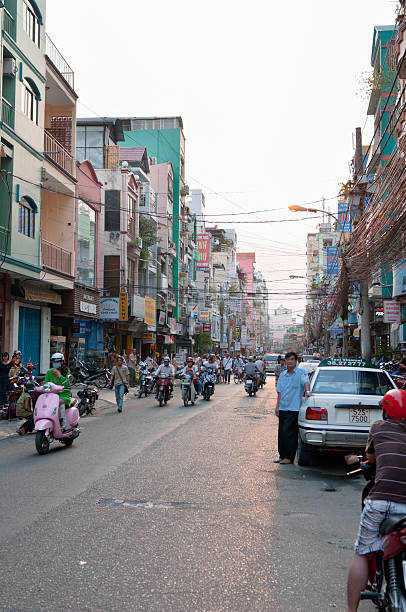 pham ngu lao street in ho chi minh city, vietnam - motorbike, umbrella stock pictures, royalty-free photos & images