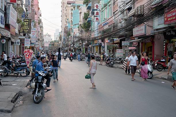 pham ngu lao street in ho chi minh city, vietnam - motorbike, umbrella stock photos and pictures