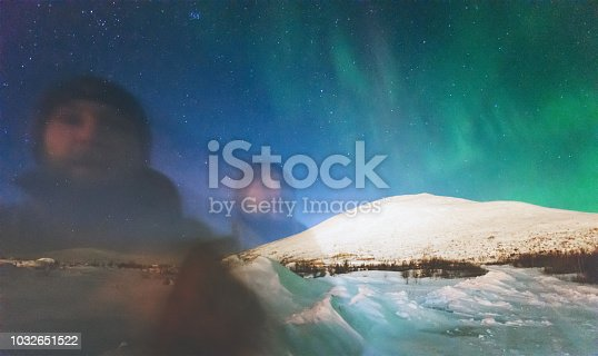 603993820 istock photo Phantom man and Northern lights view above mountains Travel Lifestyle emotional psychedelic concept into the wild night scene double exposure 1032651522