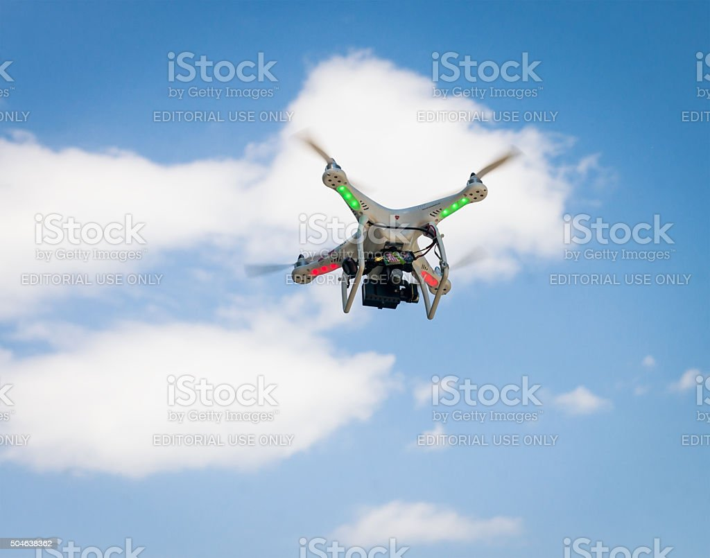 DJI Phantom quadcopter in flight stock photo