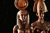 Pharaoh Tutankhamun with the goddess ISIS on a black background. Egyptian history.
