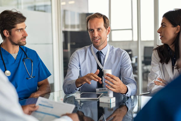 Pharmaceutical advisor showing new medicine stock photo
