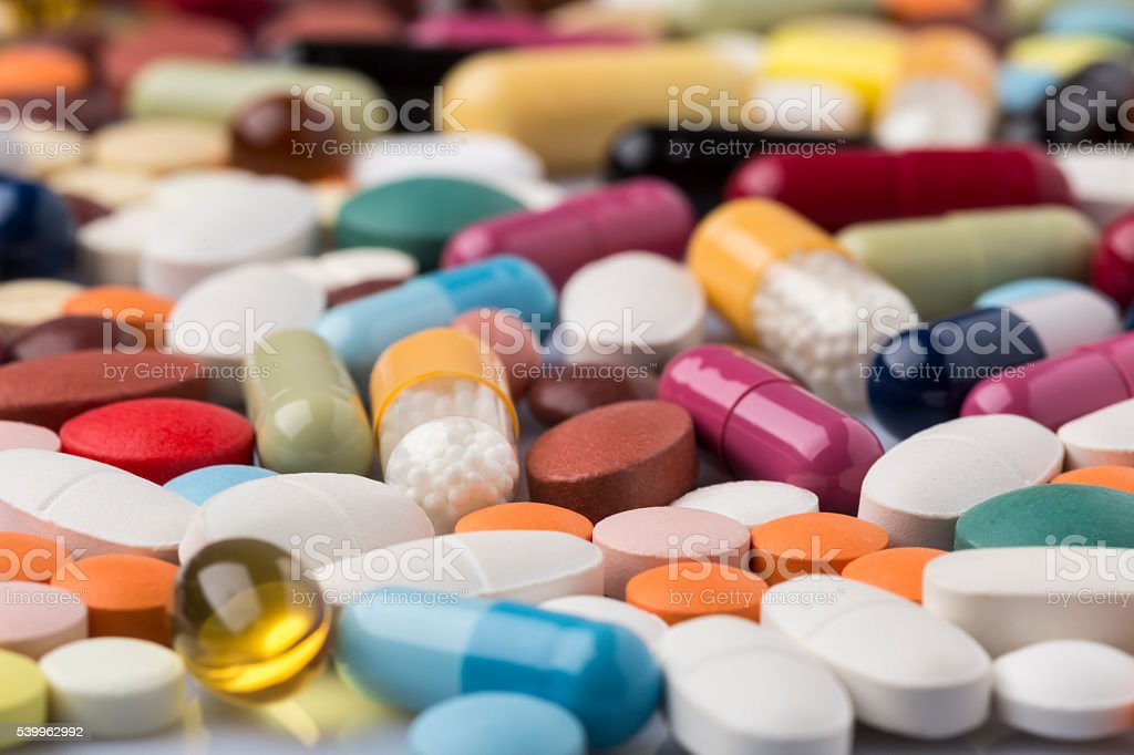 Pharmaceutical background of colorful pills and drugs stock photo