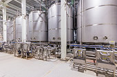 istock pharmaceutical factory equipment mixing tank on production line 685859864