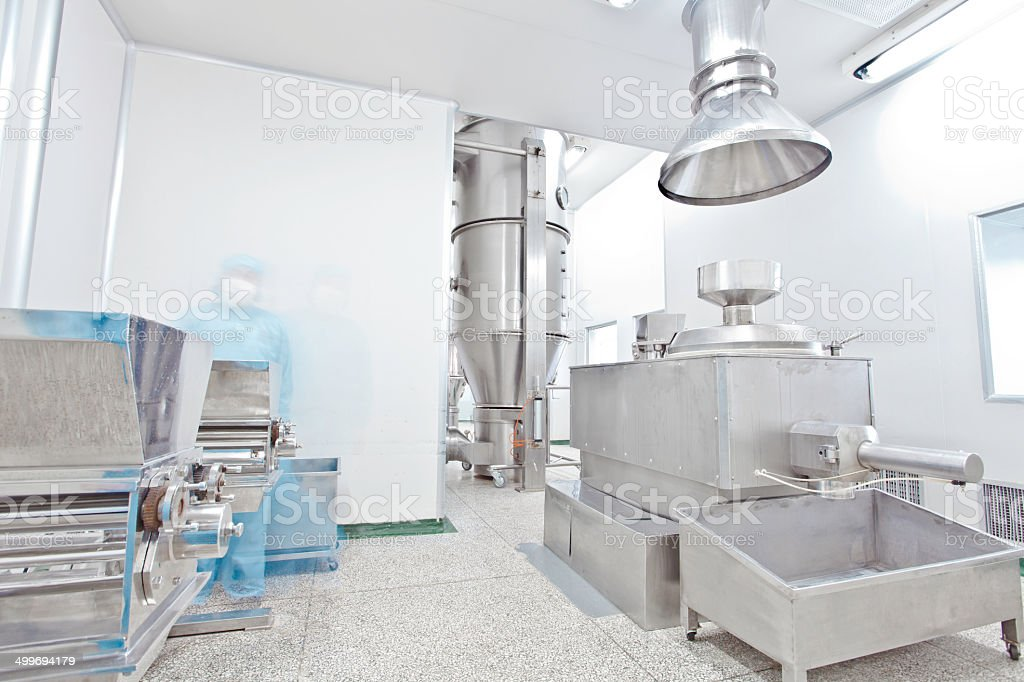 pharmaceutical factory equipment working with unrecognizable...