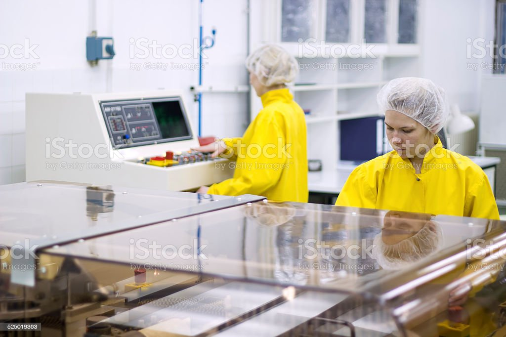 Pharmaceutical Manufacturing Technicians on the Production Line stock photo