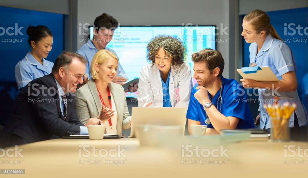 pharmaceutical rep with medical team stock photo