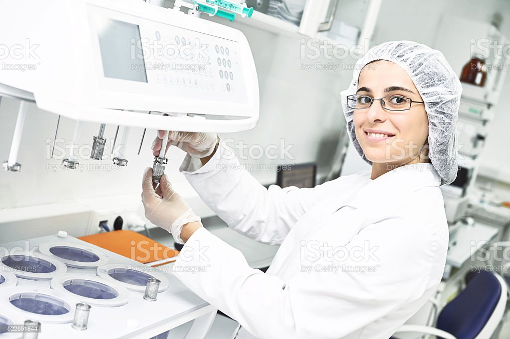 Pharmaceutical researcher making dissolution test stock photo