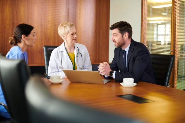 pharmaceutical sales rep with medical team stock photo
