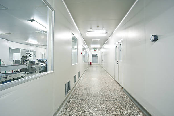 Pharmaceutical, sterile shop interior hallway Pharmaceutical, sterile shop interior hallway cleanroom stock pictures, royalty-free photos & images