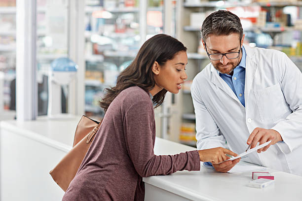 Pharmacist are the least expensive and most accessible health resource stock photo