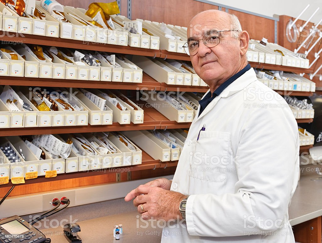 Pharmacist at the pharmacy counter royalty-free stock photo