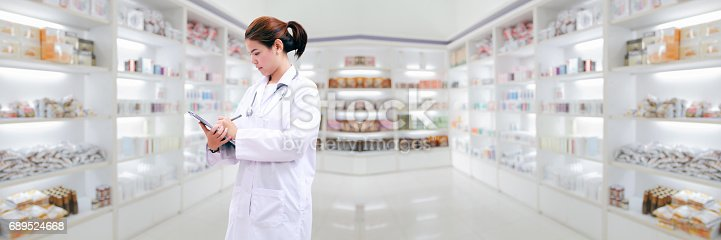istock pharmacist chemist and medical doctor woman asia with stethoscope and clipboard checking medicine cabinet and pharmacy drugstore . 689524668