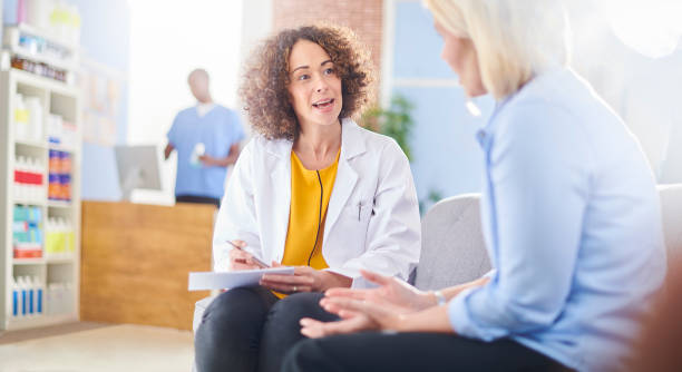 pharmacist discussing treatment plan meds - prescription meds stock pictures, royalty-free photos & images