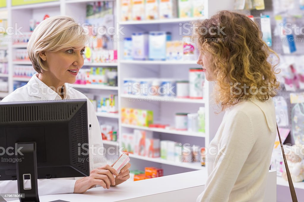 Pharmacist explaining the drug to patient royalty-free stock photo
