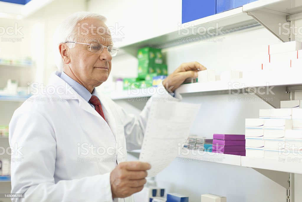 Pharmacist filling prescription royalty-free stock photo