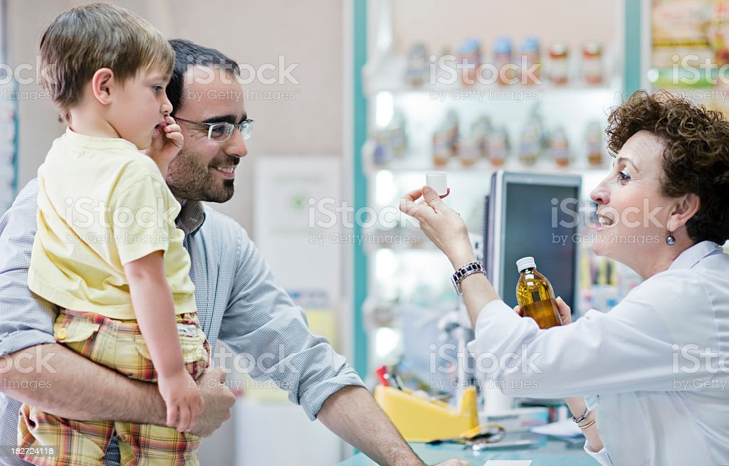 Pharmacist giving advice royalty-free stock photo