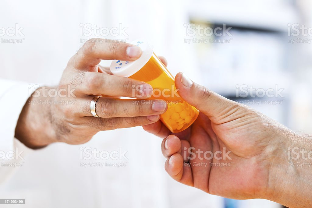 Pharmacist giving pills to customer stock photo