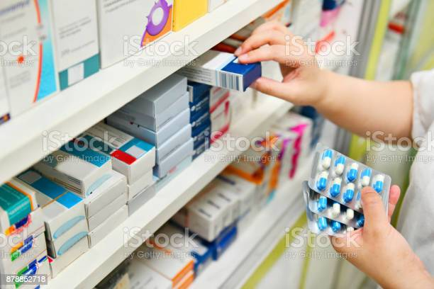 Pharmacist holding medicine box and capsule pack picture id878852718?b=1&k=6&m=878852718&s=612x612&h=ri3ywbvcaikbtbijyj5aobi2jsosbpib2kg6hhqqcpc=