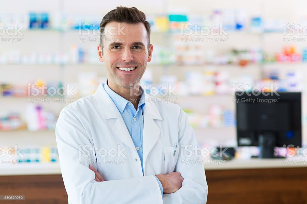 Pharmacist in drugstore stock photo