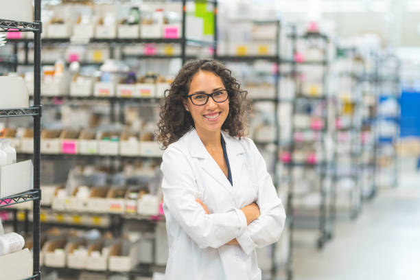 Pharmacist in stockroom stock photo