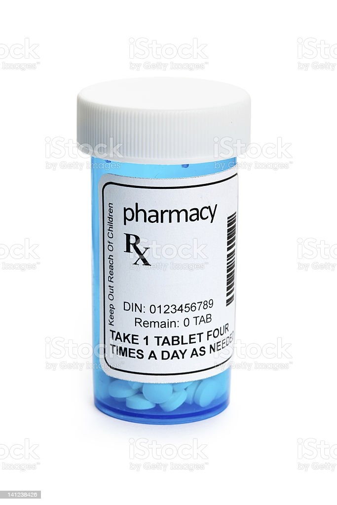 Pharmacist pill bottle with label against white background royalty-free stock photo