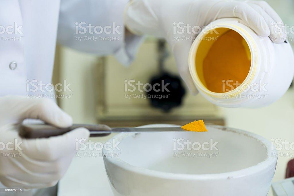 Pharmacist preparing drugs stock photo