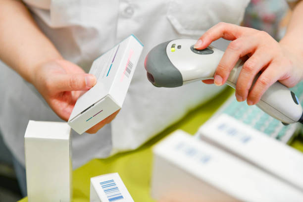 Pharmacist scanning barcode of medicine drug stock photo