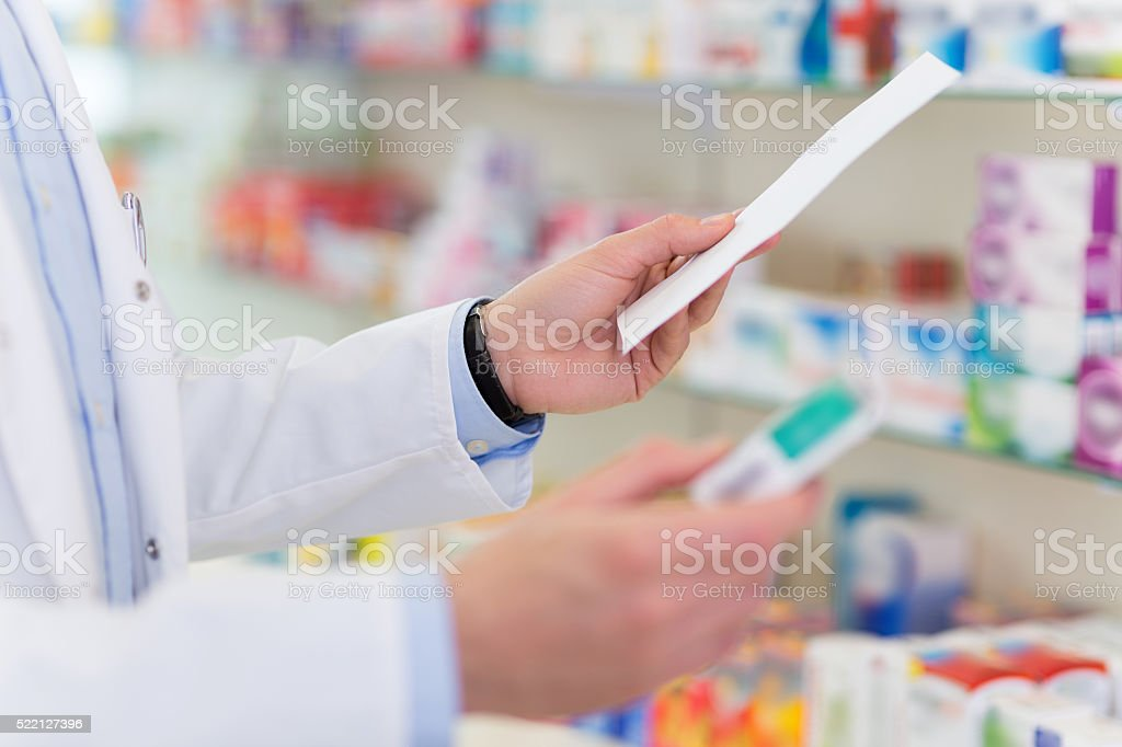 Pharmacist searching the right medicine stock photo