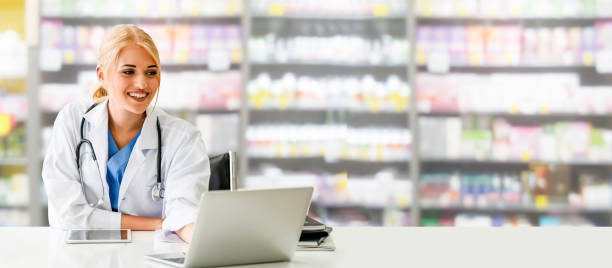 Pharmacist using laptop computer at pharmacy. Pharmacist or doctor using laptop computer at the pharmacy room. Medical healthcare and pharmaceutical staff service. pharmacist stock pictures, royalty-free photos & images