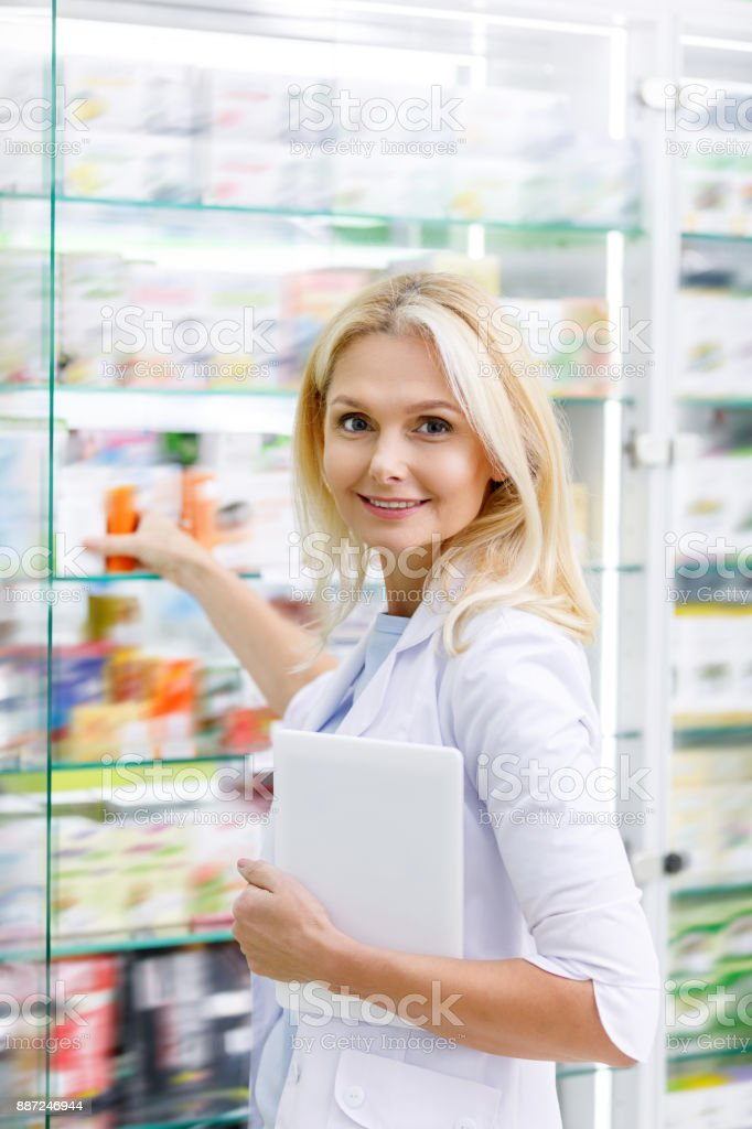 pharmacist with digital tablet in drugstore stock photo