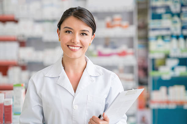 Pharmacist working at a drugstore stock photo