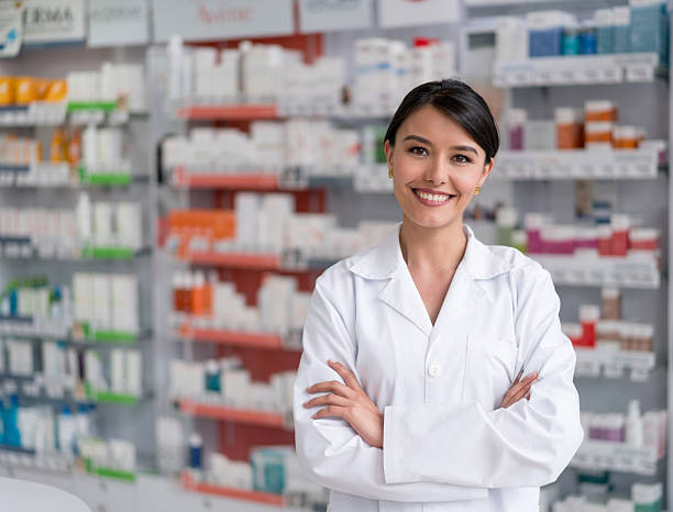 pharmacist working at the drugstore - pharmacy stock pictures, royalty-free photos & images