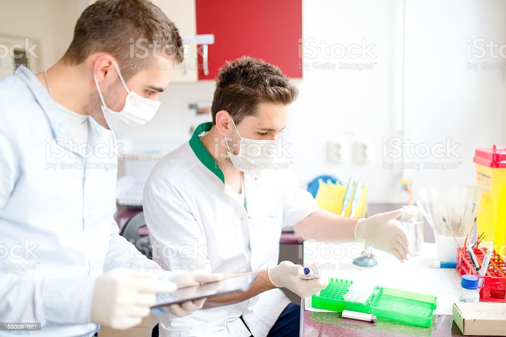 Pharmacists and scientist carrying out experiments in chemical laboratory stock photo