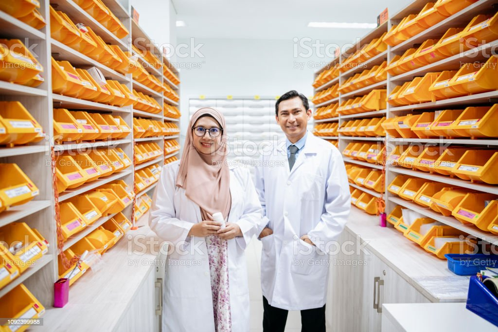 Portrait of Asian health specialists, mature male and mid adult...