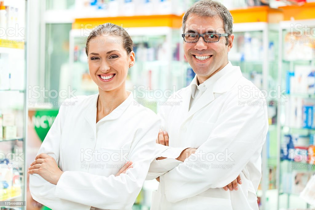 Pharmacists working in pharmacy royalty-free stock photo