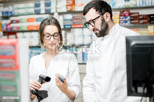 istock Pharmacists working in the pharmacy store 950296696