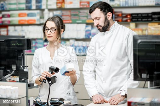 istock Pharmacists working in the pharmacy store 950296734