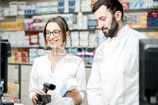 istock Pharmacists working in the pharmacy store 950296776