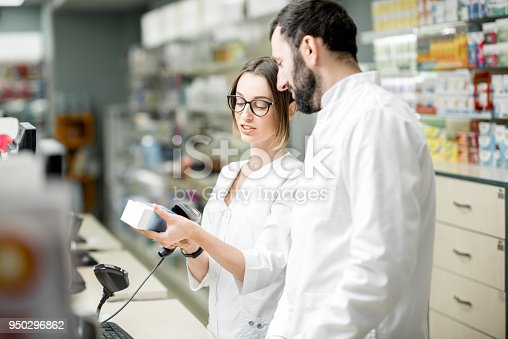 istock Pharmacists working in the pharmacy store 950296862