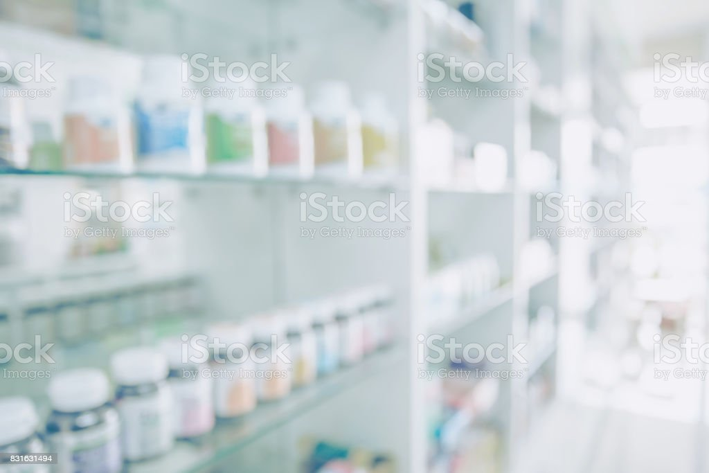Pharmacy blurred light tone with store drugs shelves interior background, Concept of pharmacist and chemist, middle east or transcontinental region centered on western asia. stock photo