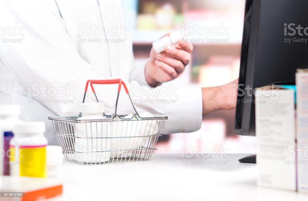 Pharmacy Cashier Or Clerk At Counter Pharmacist Using Cash Register