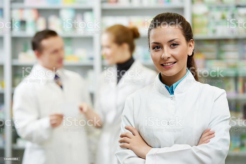 Pharmacy chemist woman in drugstore stock photo