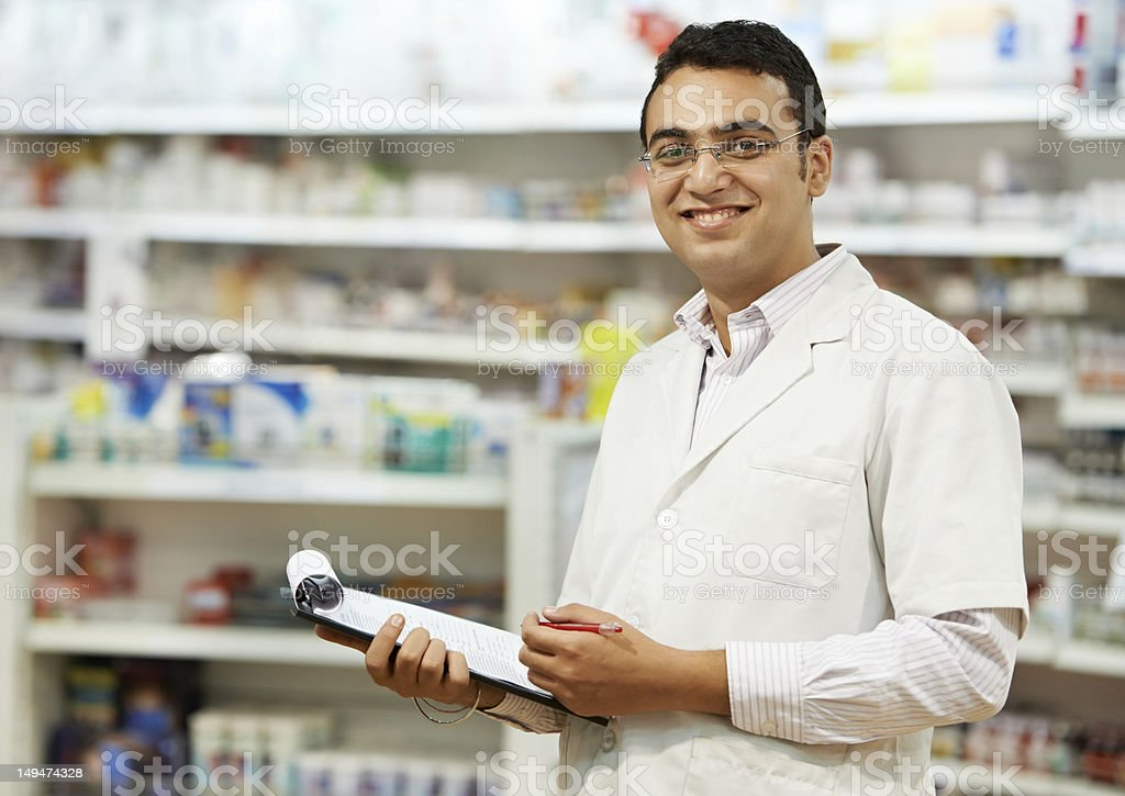 Pharmacy chemist woman in drugstore royalty-free stock photo