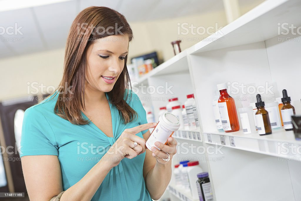 Pharmacy customer reading label on presciption medication stock photo