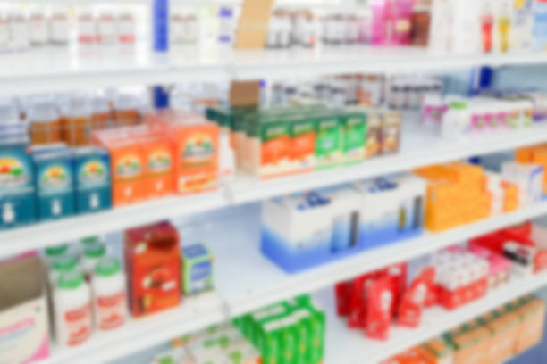 pharmacy drugstore blur abstract backbround with medicine and healthcare product on shelves - coprire foto e immagini stock